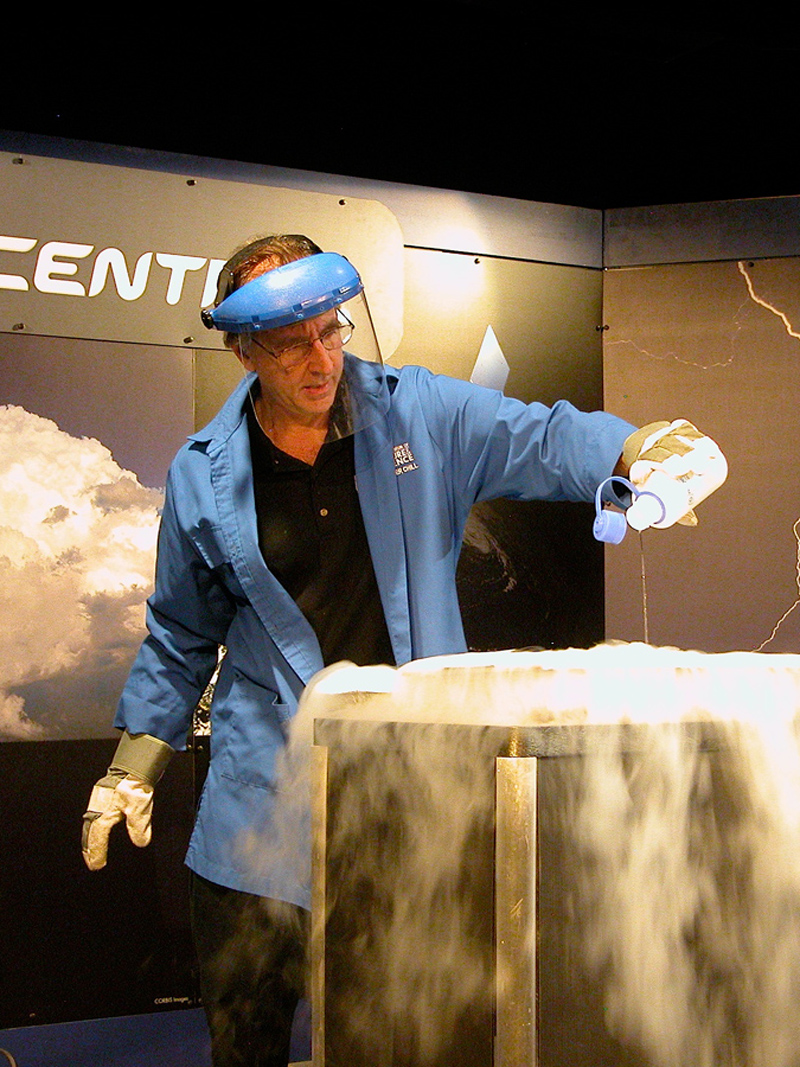 Eddie Goldstein making a cloud with liquid nitrogen in a science demonstration about weather
